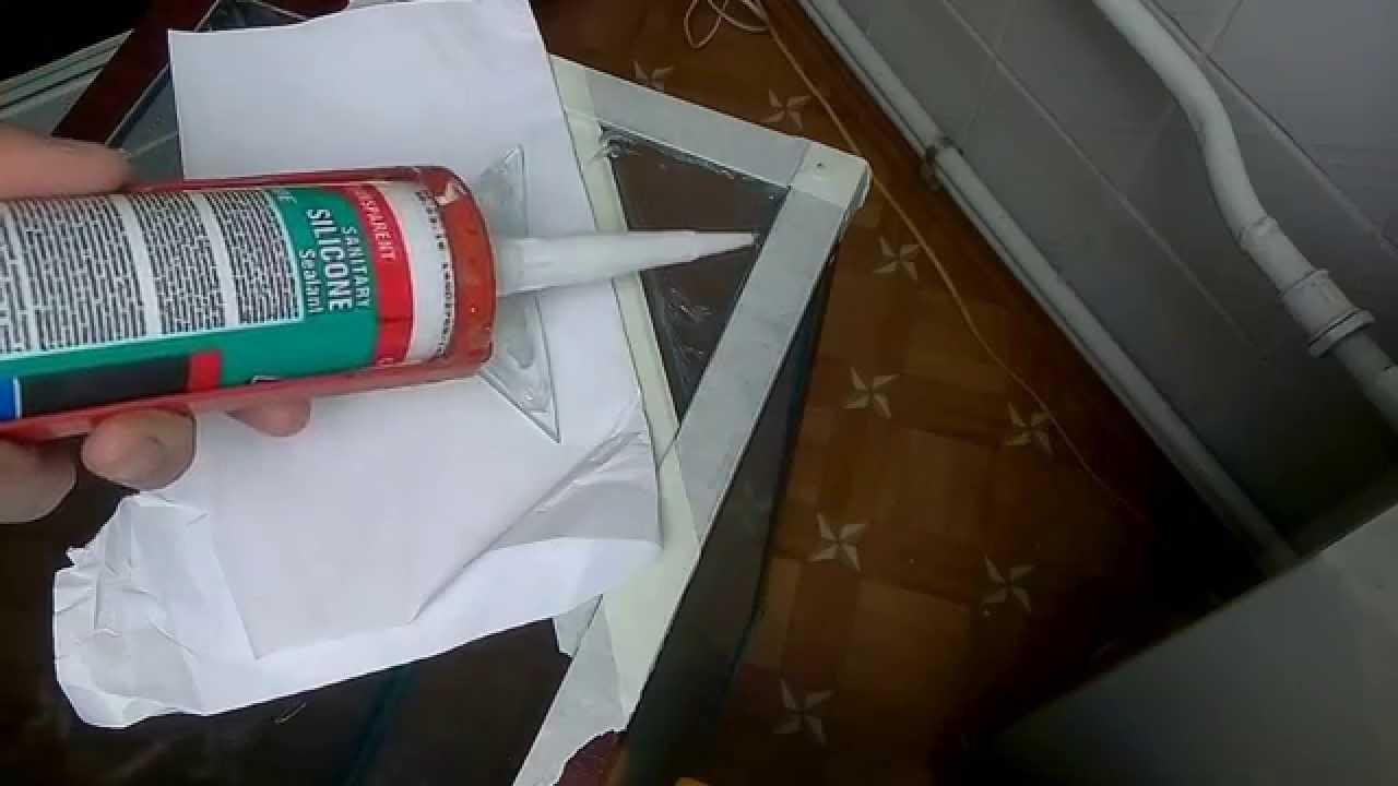 Процесс склейки стекол аквариума